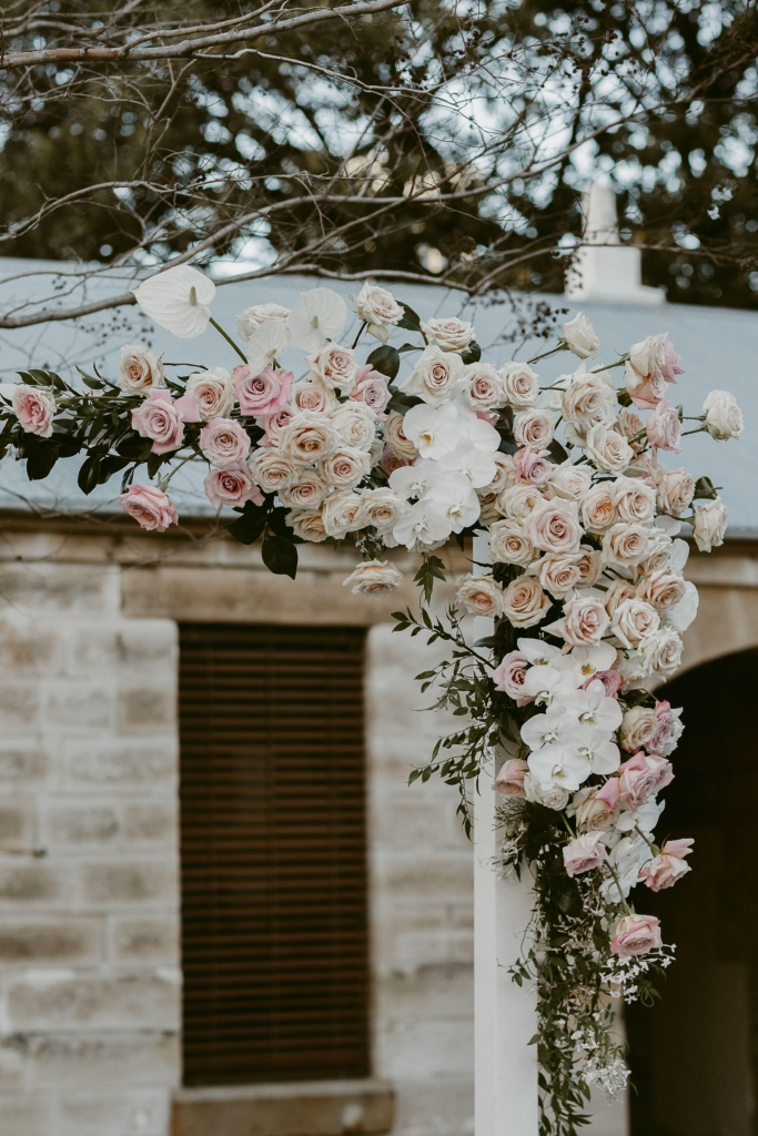 Roses and orchids on wedding arch